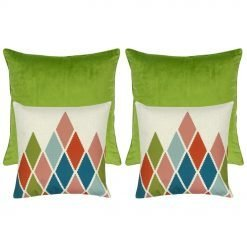 two green cushion covers and two diamond patterned cushion covers