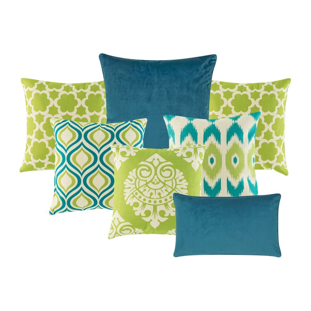 5 Multi-patterned cushion with lime green and teal colours, one plain blue cushion and one rectangular cushion in blue.