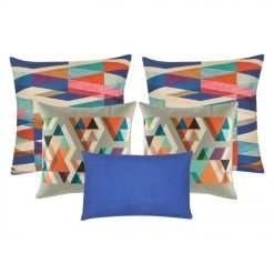 A collection of five square and rectangular blue and grey cushions with triangle patterns