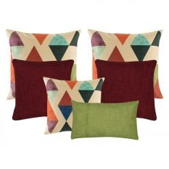 A collection of red, green and multi-colored cushions with diamond and triangle patterns
