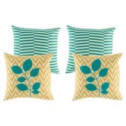 A collection of 4 cushions in green and gold colours, with line, leaf and zigzag patterns