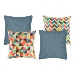 A set of 4 denim and rainbow coloured cushions with diamond and zigzag patterns