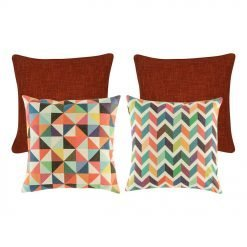 A pair of plain red cushion covers, and two pieces of rainbow coloured cushion covers