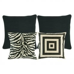 one cushion with black and white square pattern, a zebra print cushion and two plain black cusion