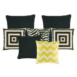 A collection of black, white and yellow cushions in chevron, square and animal print patterns