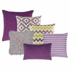 Three purple coloured cushion covers with diamond, chevron and arrow design, one fur lilac cushion cover, one plain purple square cushion cover and one rectangular purple cushion cover