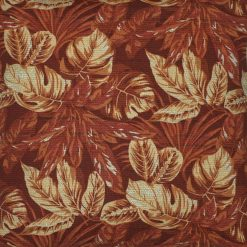 Close up photo of square red orange russet outdoor cushion cover with leaf design