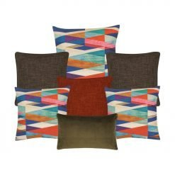 Two plain bron cushion, one burnt orange cushion, three cushion cover with patterns, and one brown rectangle cushion