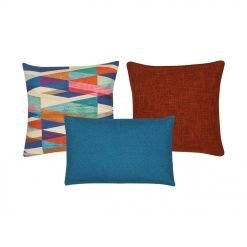 A patterned cushion cover, a plain orange cushion cover and one rectangle cushion cover in blue.