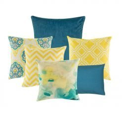 A collection of 6 square and rectangular blue and yellow cushion covers with diamond and chevron patterns