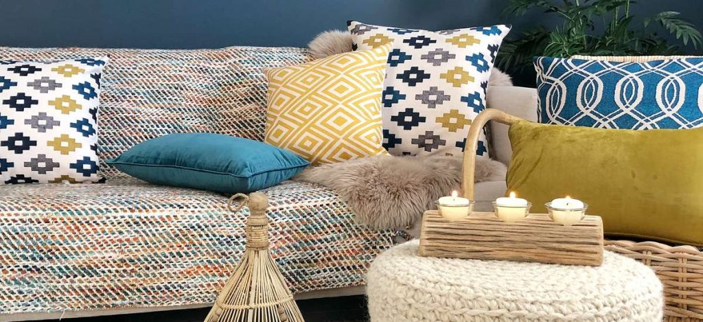 Lovely eclectic boho chic styled room with blue and mustard cushions and funky ornaments
