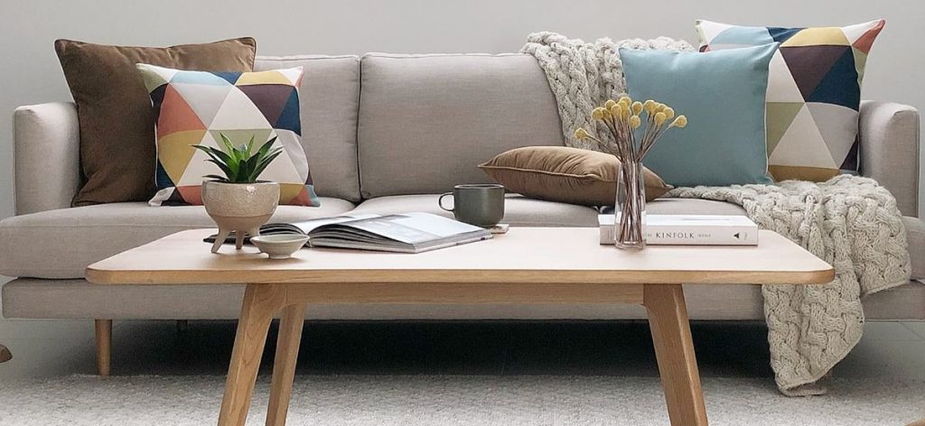 Neutral sofa with two two one cushions arrangement