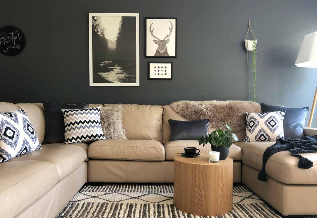 Cushion in hues of black, grey and white in different patterns