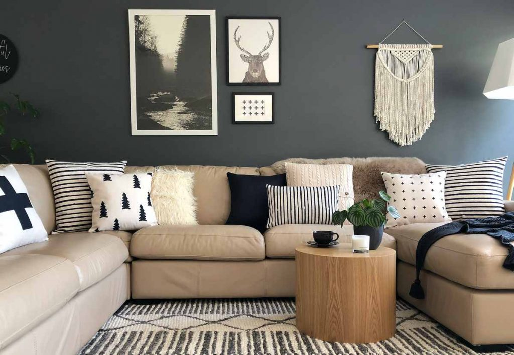 A cozy sofa perfect for lounging, decorated with cushions in in Scandi inspired patterns
