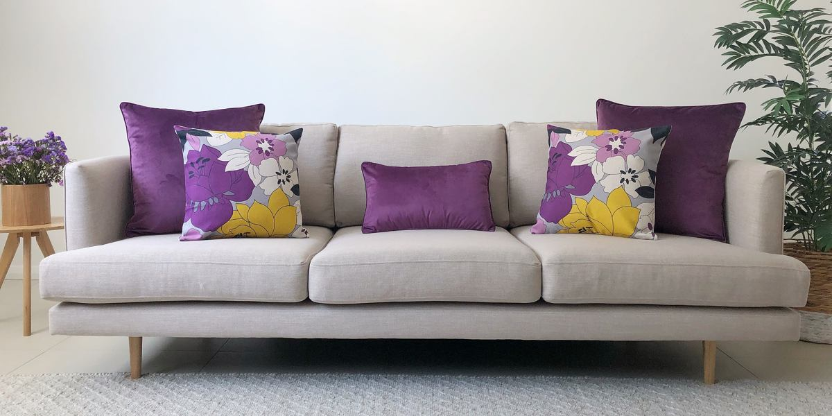 Grey sofa with velvet purple and floral cotton linen cushions
