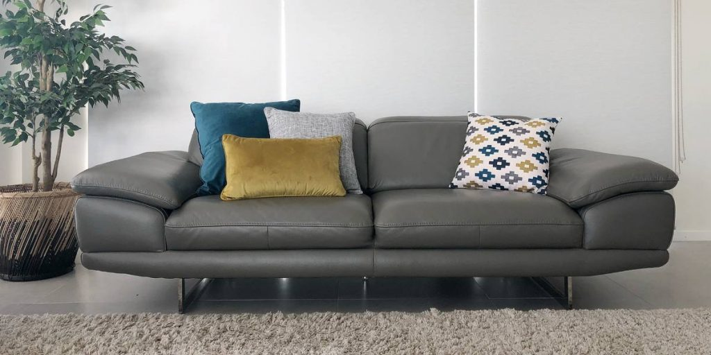 Grey sofa and a 3-1 cushion arrangement with cushions in teal and mustard
