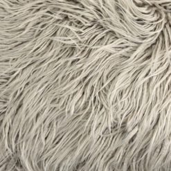 Close up photo of 30cm x 50cm rectangular faux fur cushion in ecru colour