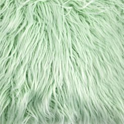 Close up image of green rectangular faux fur cushion cover in 30cm x 50cm size